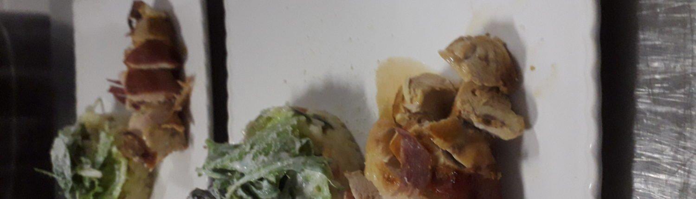 Gevulde kip in jasje van jambon cru met een groenterisotto